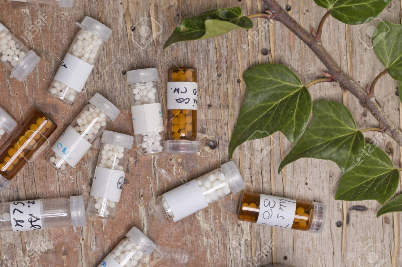 bottles with homeopathy globules and homeopathy liquid