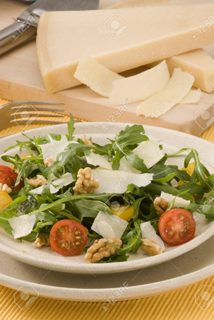 Rocket and parmesan shavings salad in a ceramic dish  Selective focus Stock Photo - 15734061