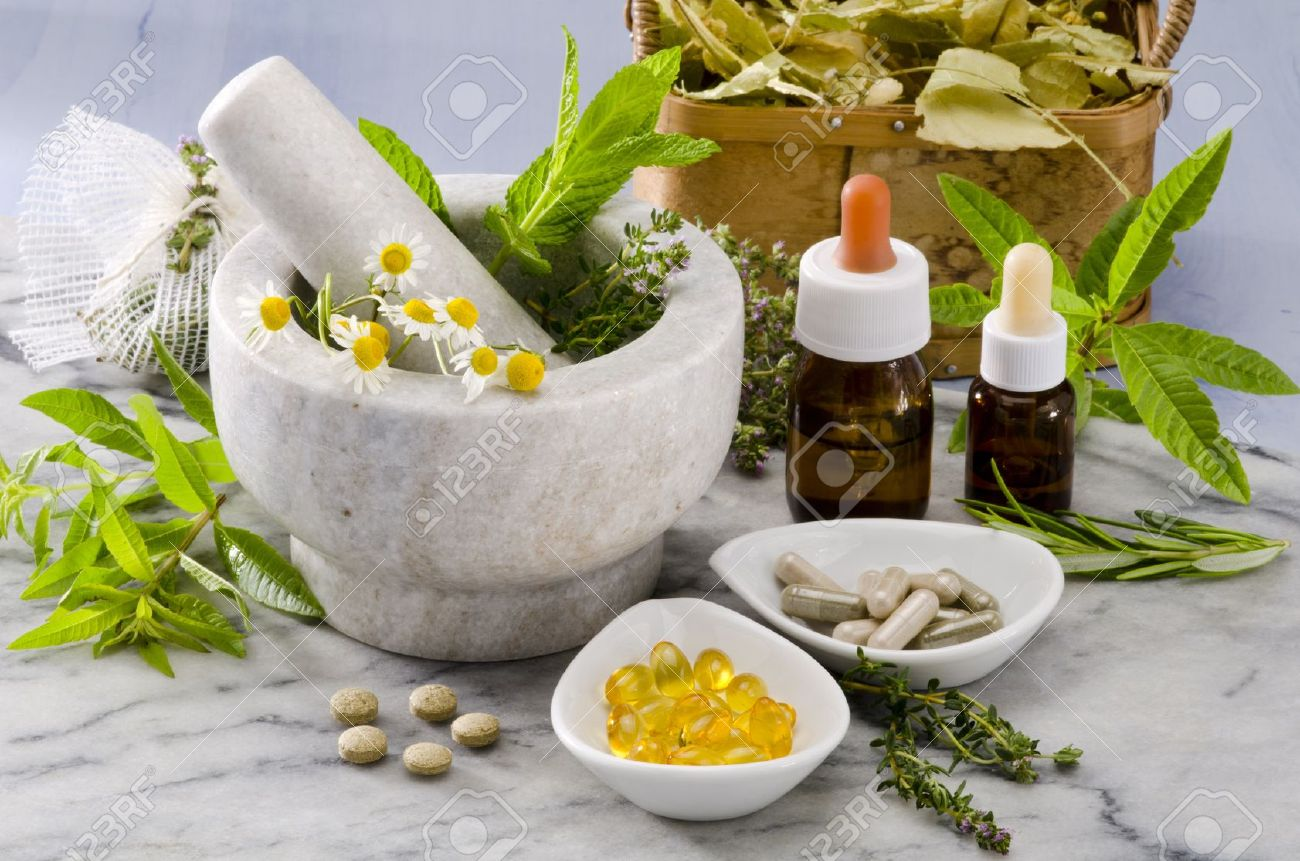 Alternative Medicine. Rosemary, mint, chamomile, thyme in a marble mortar. Essential oils and herbal supplements. - 19914028