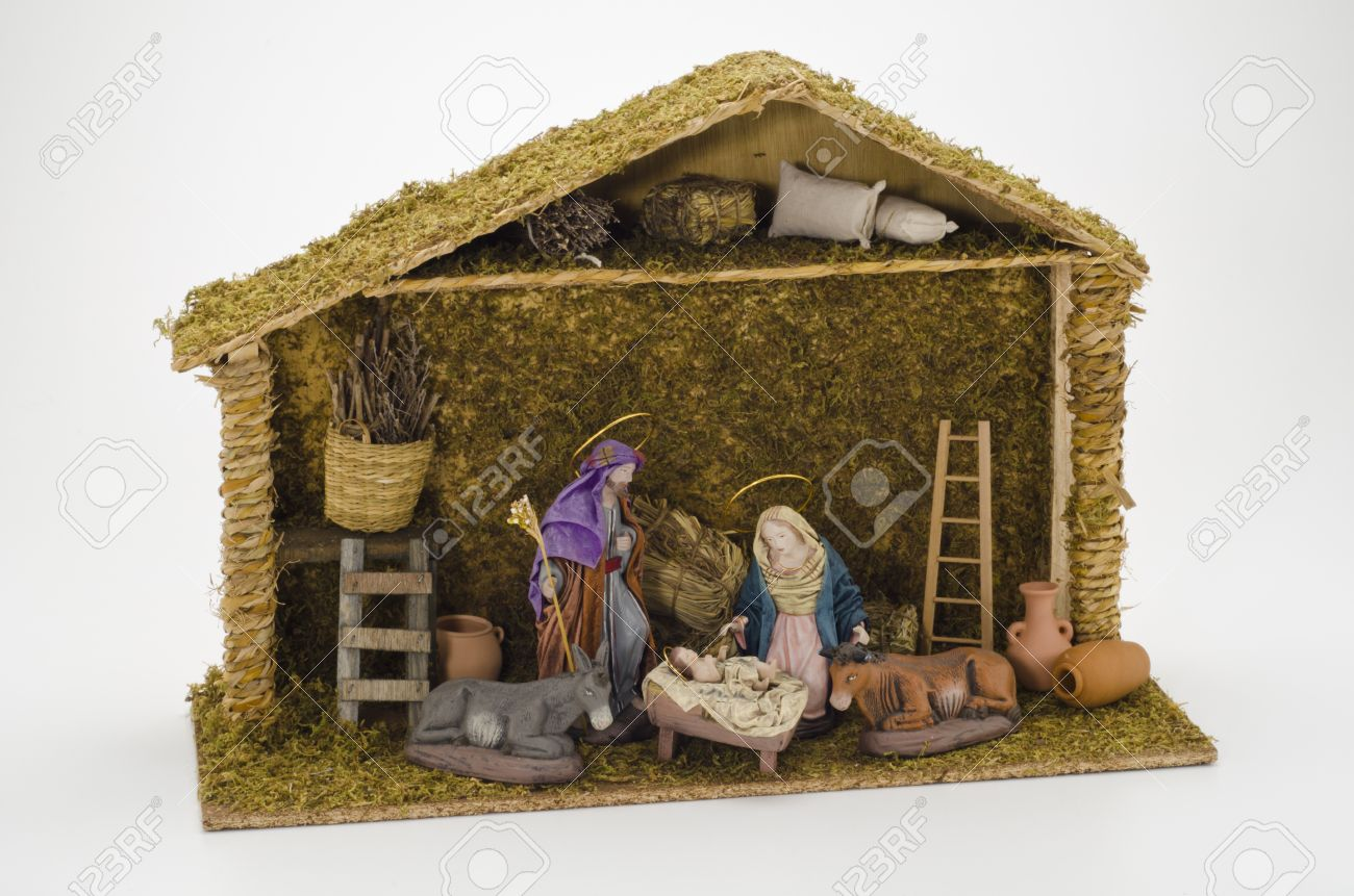 Christmas Crib. Figures of Baby Jesus, Virgin Mary and St. Joseph on white background. Stock Photo - 23117814