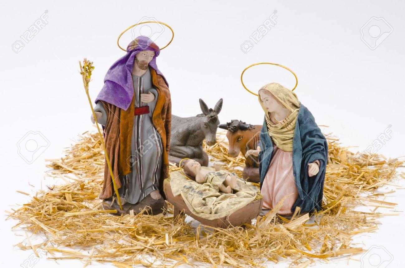 Fotos De El Pesebre De Jesus.Pesebre De Navidad Las Figuras Del Nino Jesus La Virgen Maria Y San Jose En El Fondo Blanco
