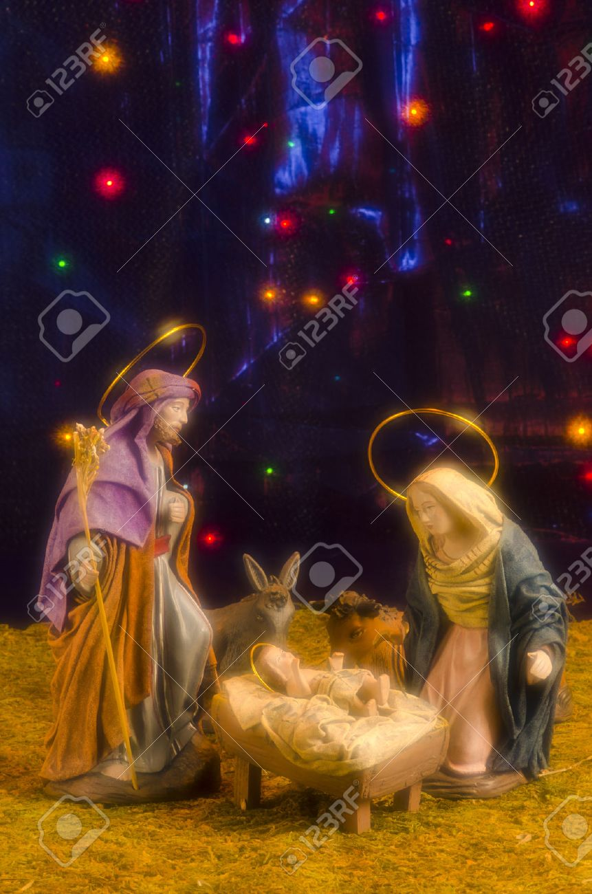 Christmas Crib. Figures of Baby Jesus, Virgin Mary and St. Joseph. Blue starry background. Soft Focus. - 23117826