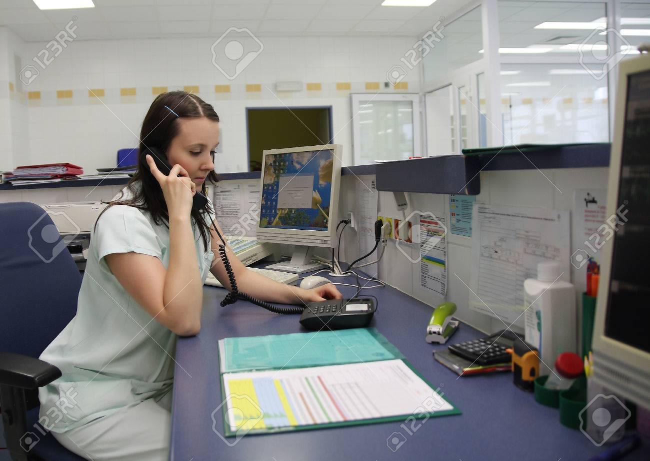 Nurse calling on phone in ICU - 33517605