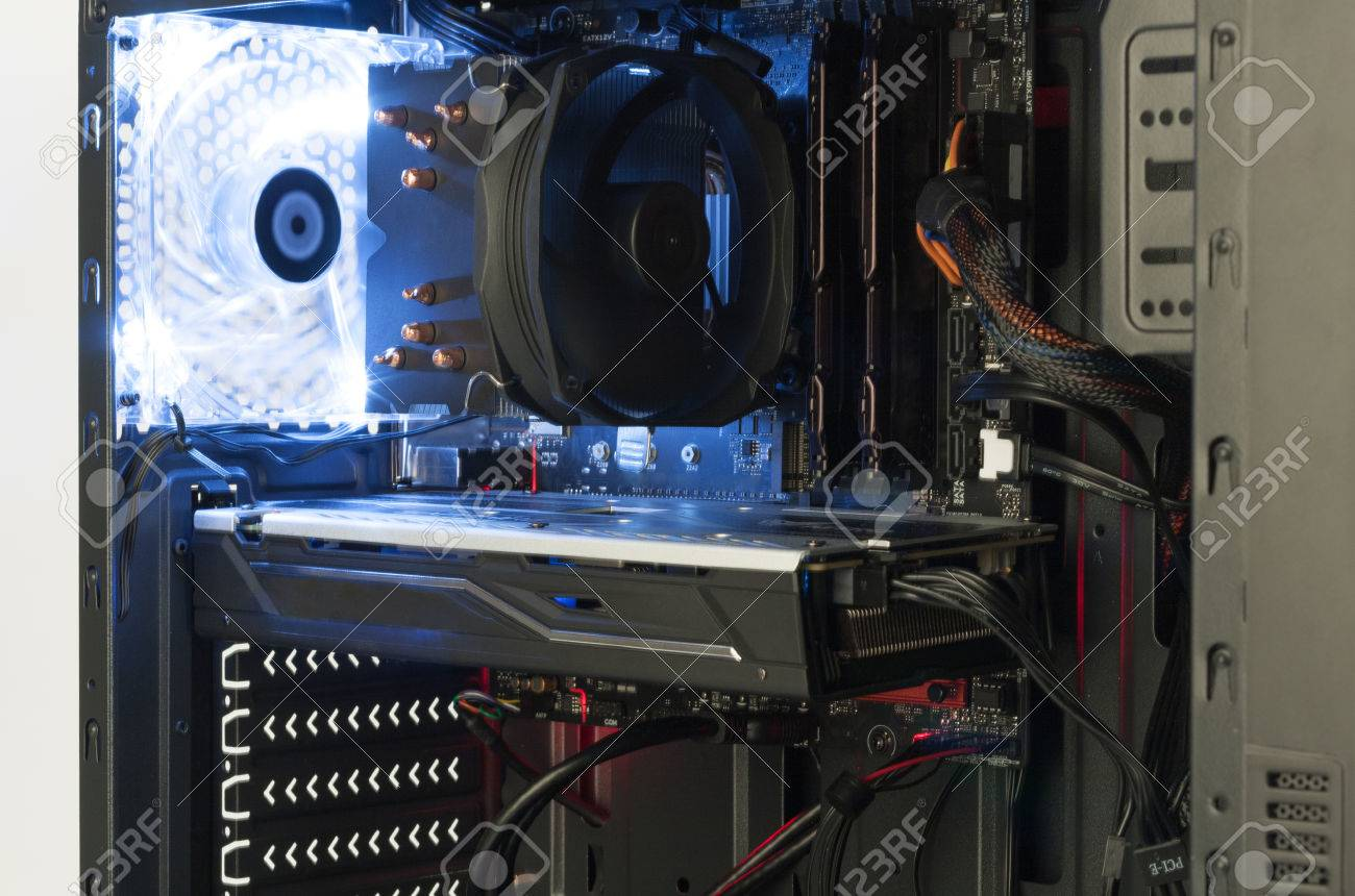 Close up view inside open midi tower computer case with red and blue lighting effects - 74550635