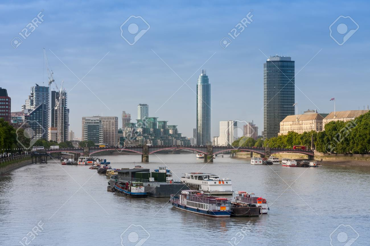 City cruise ships on the river Thames, on background Lambert Bridge and London Towers in the morning, London, England. - 90085684