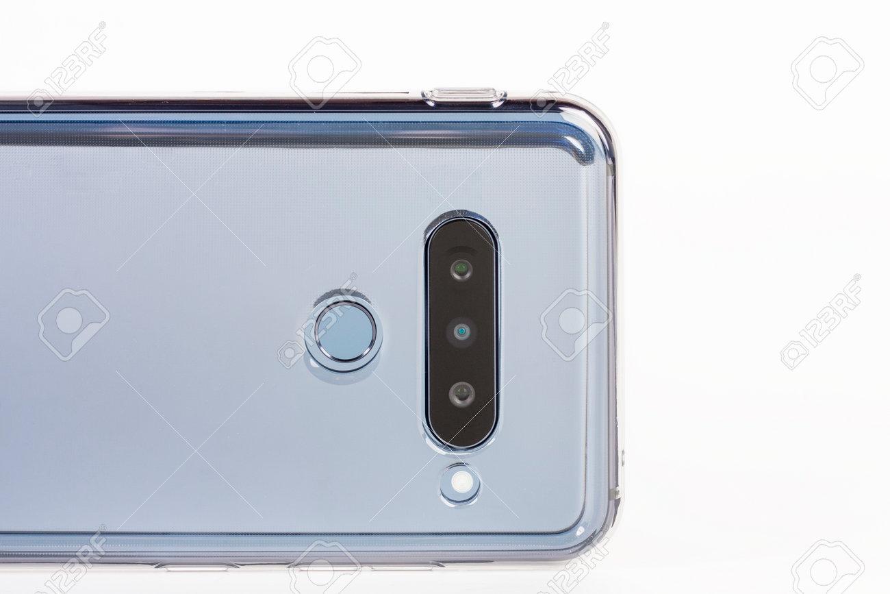 Touchscreen triple camera smartphone in silicone cover. Super Wide-Angle, standard, telephoto zoom. Fingerprint sensor. - 162659804