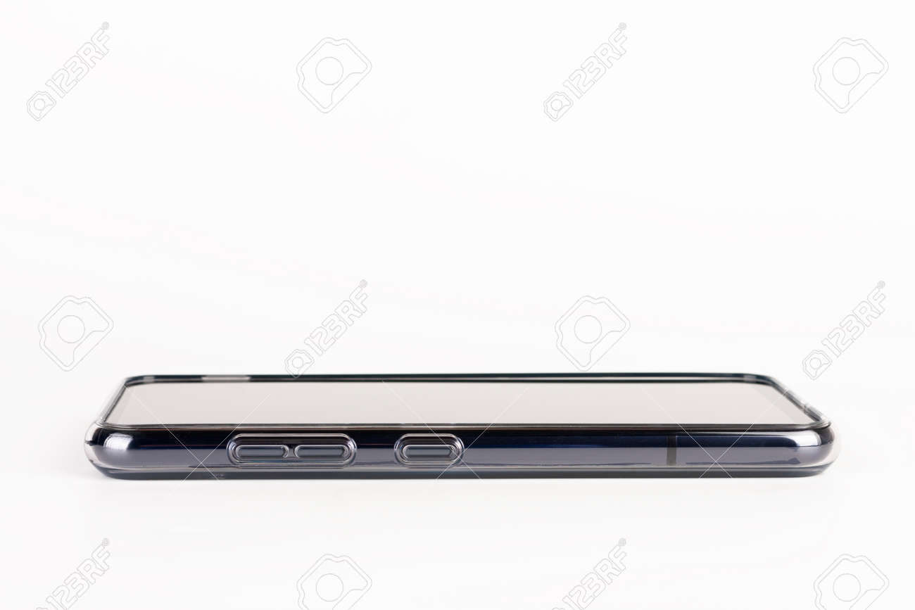 Close up of side buttons of touchscreen smartphone in silicone cover. Volume control buttons - 162659595