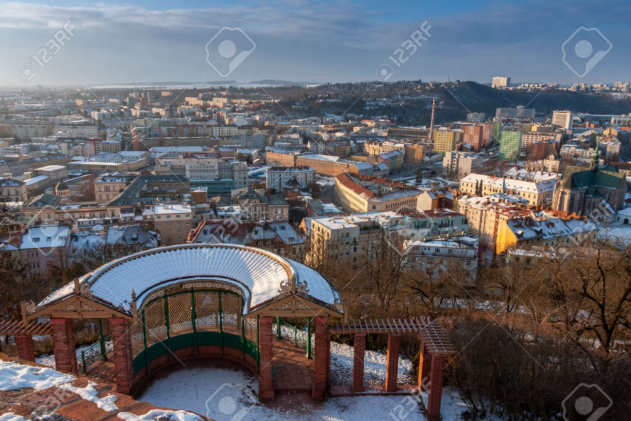 Semicircular big gazebo, nice relaxation site below the castle Spilberk in Brno in Czech Republic. Winter sunrise time. Panoramic view of Brno city. - 163052068