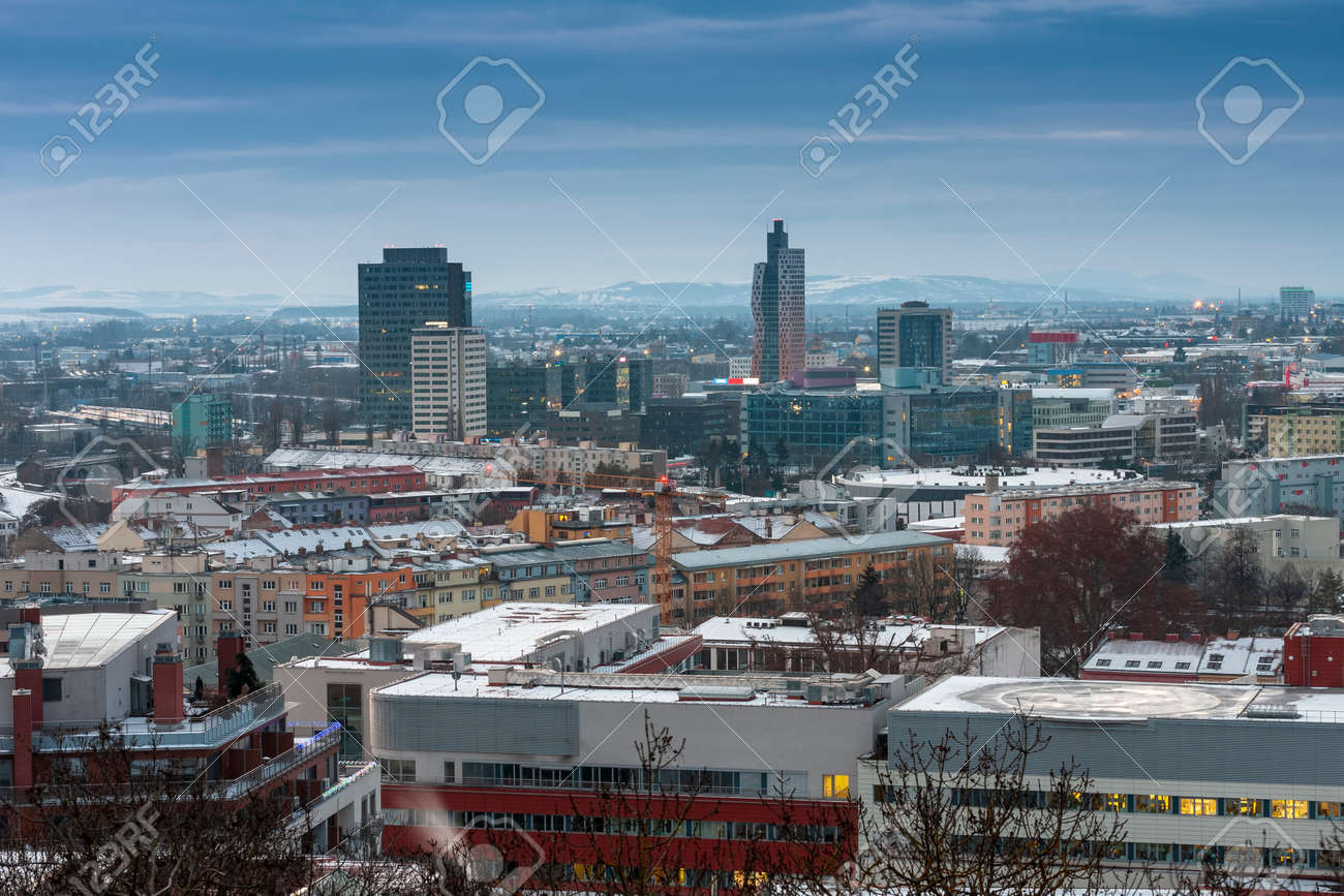 Panoramic view of Brno in Czech Republic. There is a hospital with heliport in the foreground. - 163069072