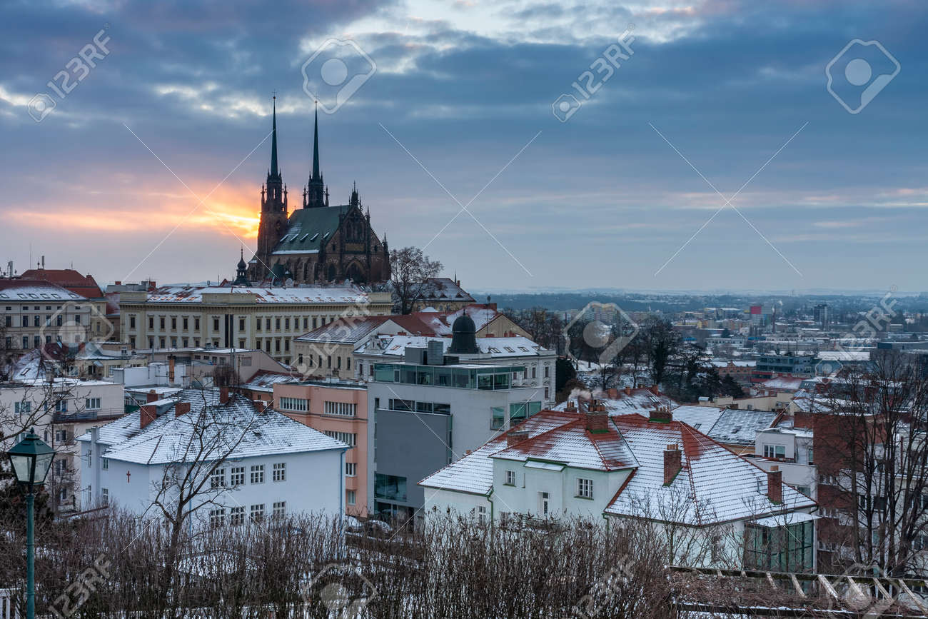 Aerial view of the Cathedral of Saints Peter and Paul in Brno in Czech Republic. Winter sunrise time. View from Spilberk Castle - 163068769