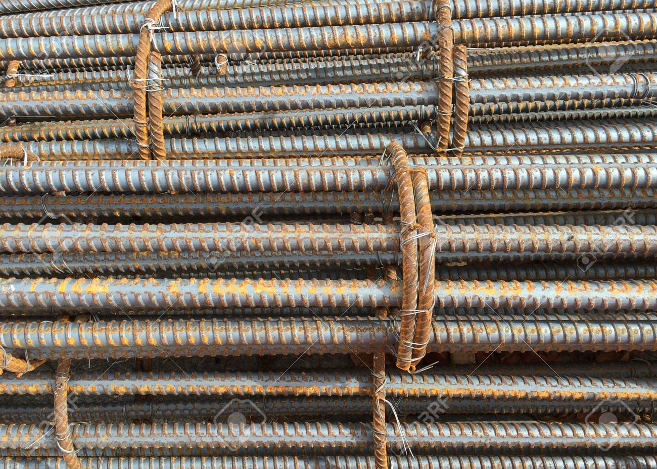 Close-up photo of a rebar, reinforcing bar, reinforcing steel and reinforcement steel, a steel bar or mesh of steel wires used as a tension device in reinforced concrete and masonry structures. - 106216086