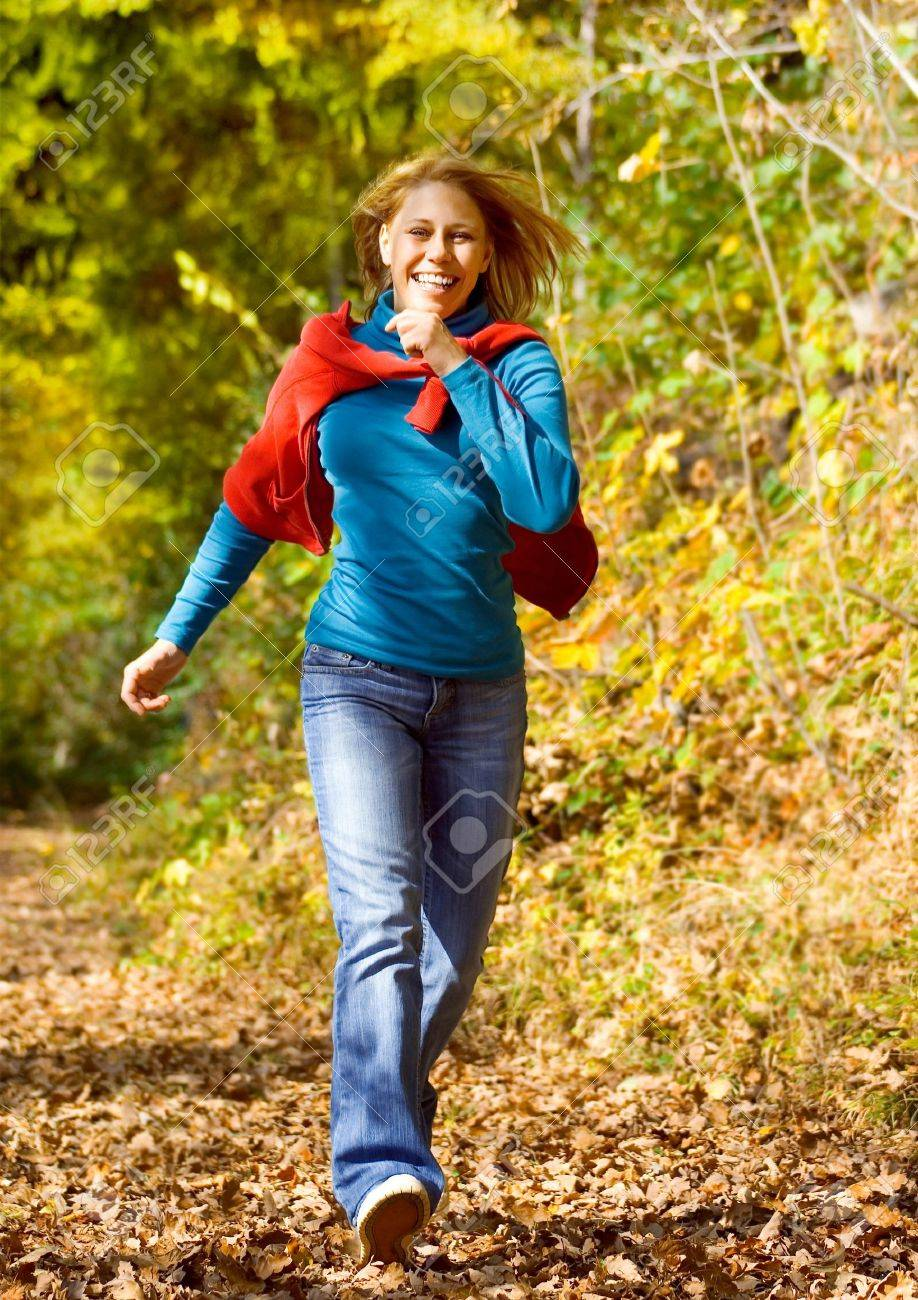 girl taking a walk in an autumn-forest Stock Photo - 5512279