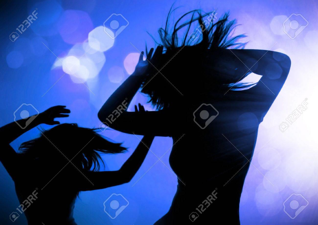 dancing silhouettes of women in a nightclub Stock Photo - 7588119