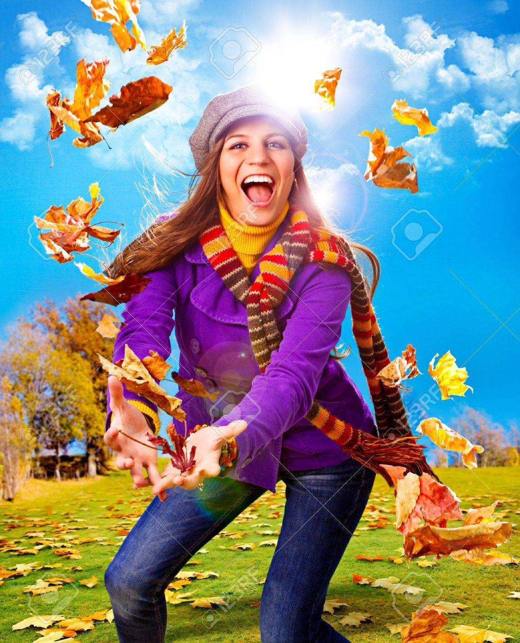 young happy woman with foliage in autumn Stock Photo - 7588291