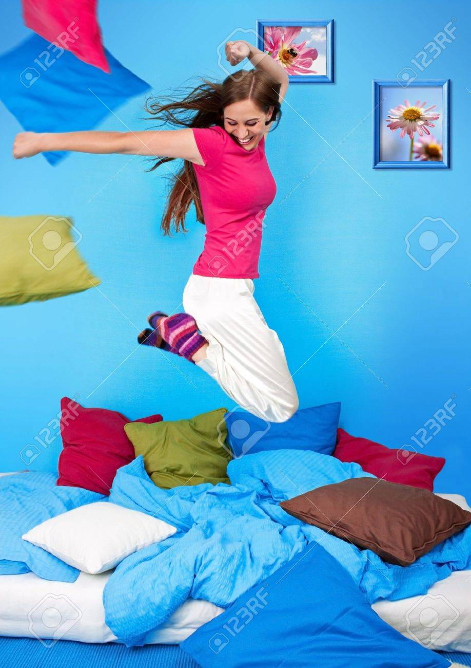 young teenage-woman is making a pillow-fight Stock Photo - 7588165
