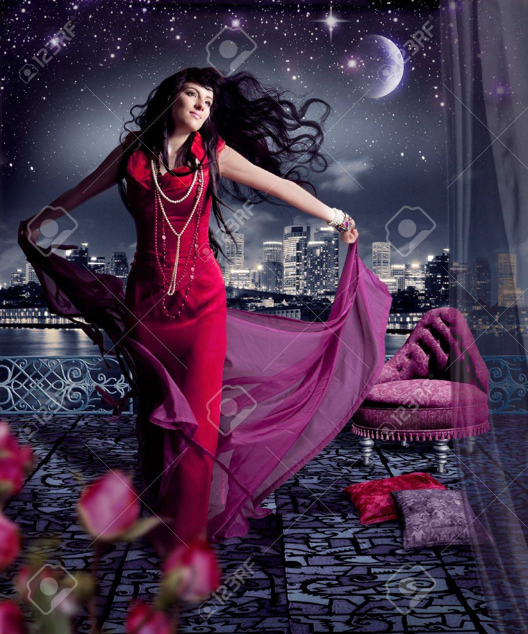 beautiful girl in evening dress on a terrace Stock Photo - 15385393