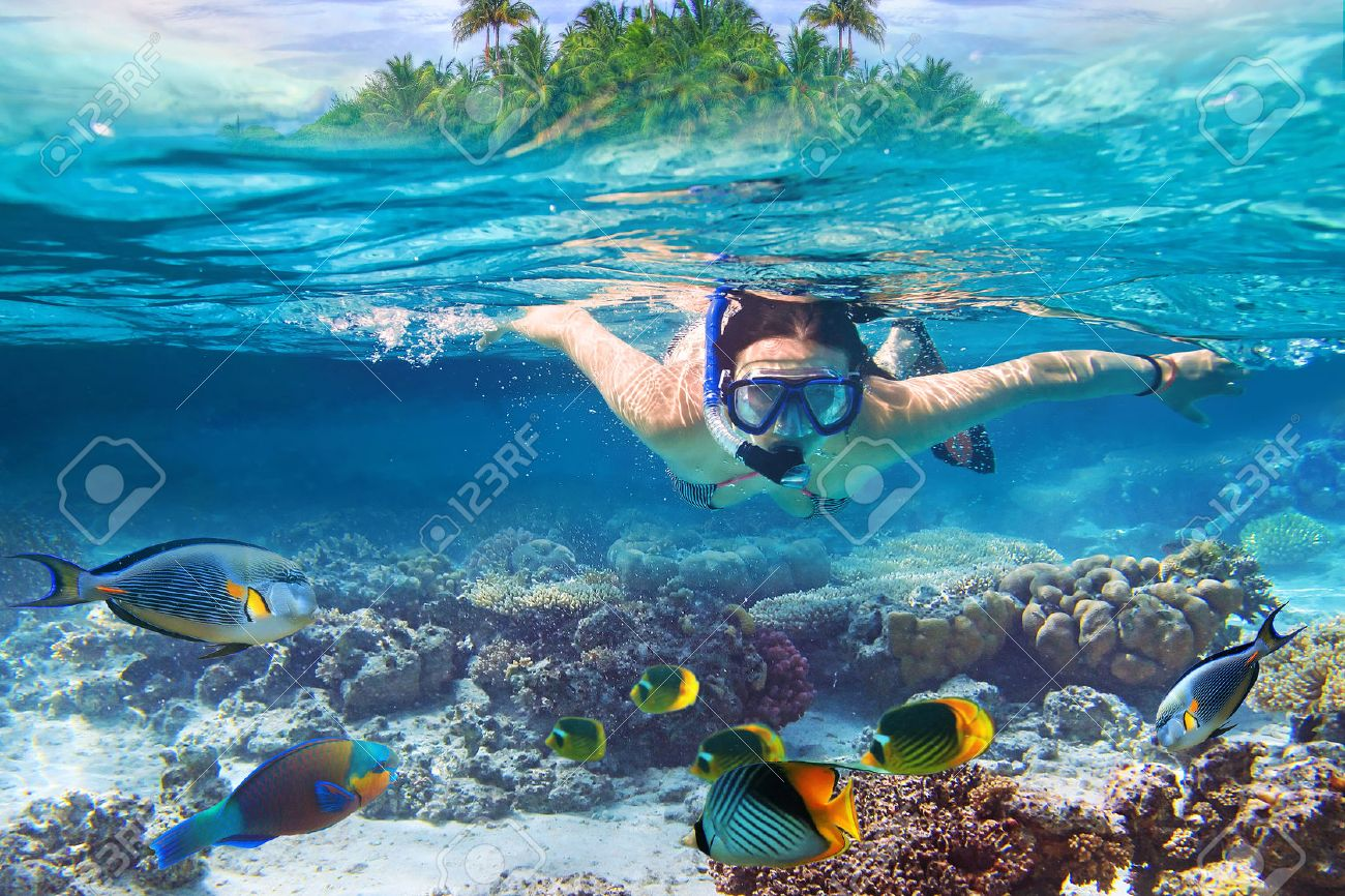 Young women at snorkeling in the tropical water Stock Photo - 53176186