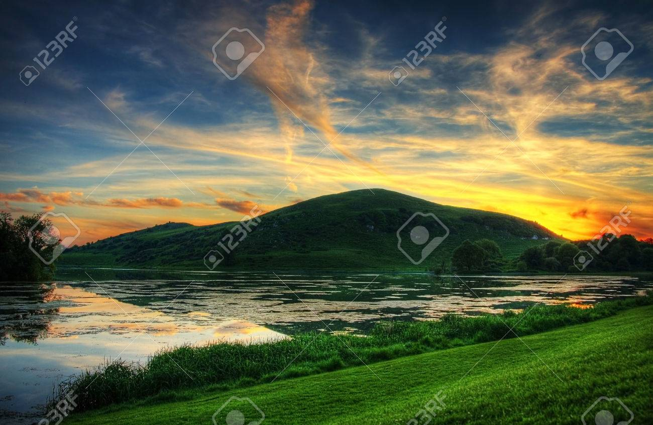 Sunset over Lough Gur lake in Ireland Stock Photo - 56298375
