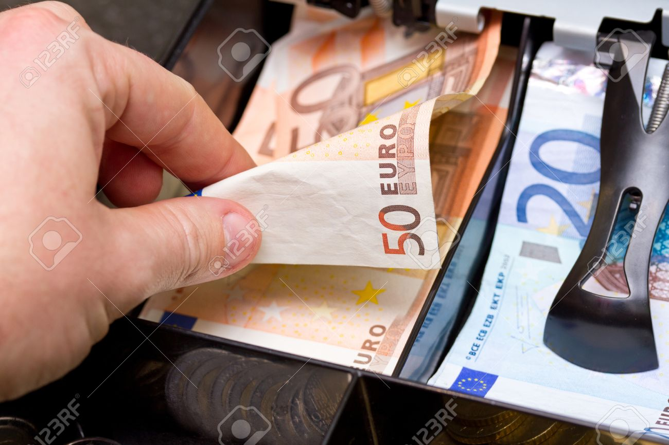 Hand taking change in euro from the till Stock Photo - 58901730