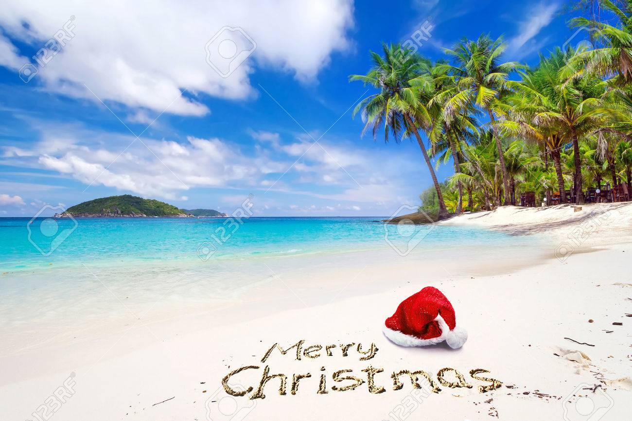 Christmas Beach.Merry Christmas Greeting With Santa Hat On The Tropical Beach