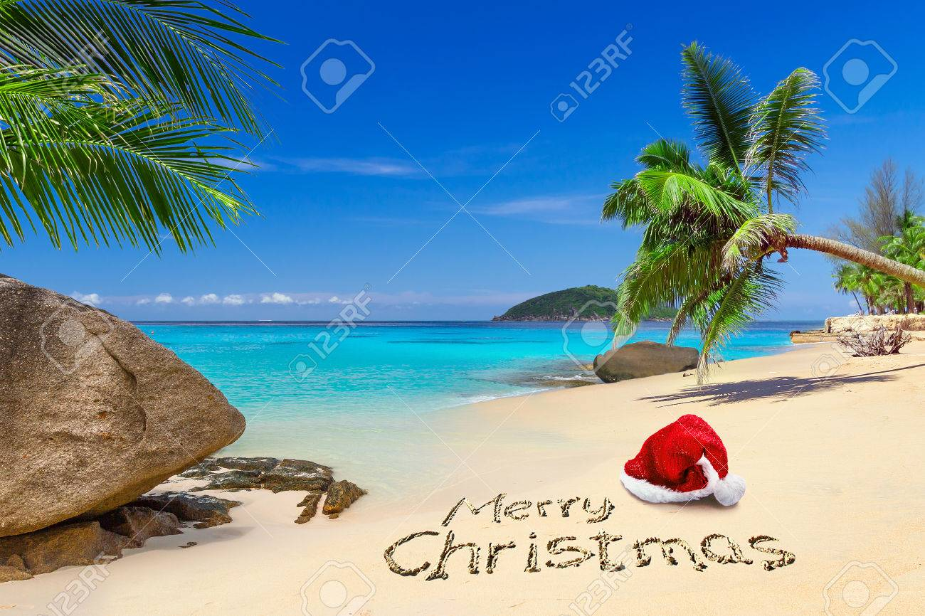 Merry Christmas greeting with santa hat on the tropical beach Stock Photo - 59458731