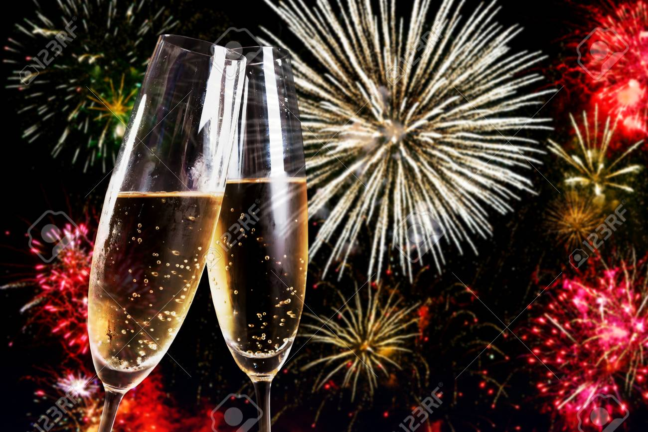 Two flutes of champagne over fireworks display Stock Photo - 59217154