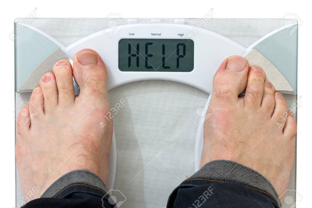 Man on weight scale Stock Photo - 58441848