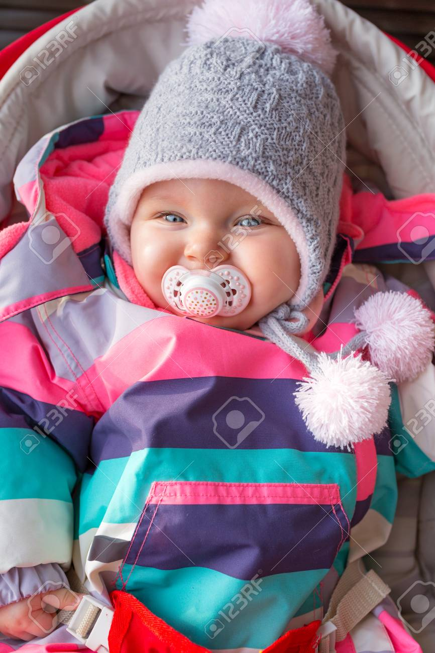 bfcf2f501 Portrait Of Baby Girl In Winter Jacket And Hat Stock Photo