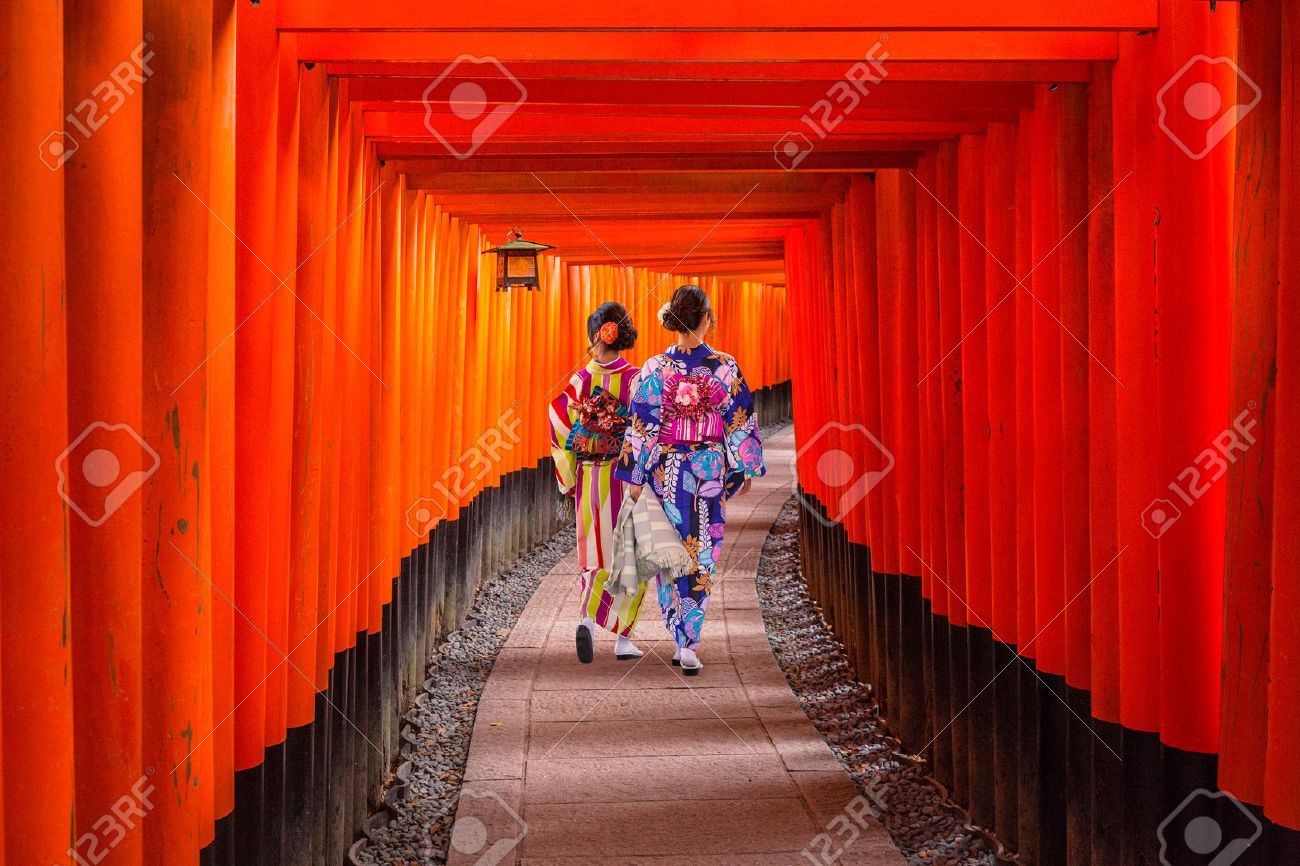 Women in traditional japanese kimonos walking at Fushimi Inari Shrine in Kyoto, Japan Stock Photo - 68542965