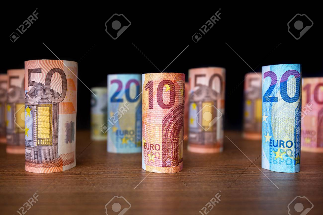 Rolled up euro banknotes on the desk Stock Photo - 75224705