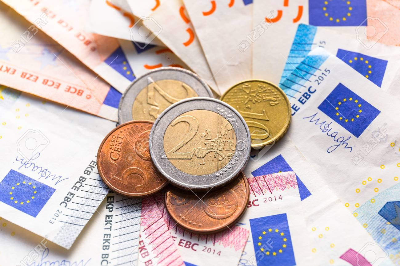 Euro money banknotes and coins Stock Photo - 75630667