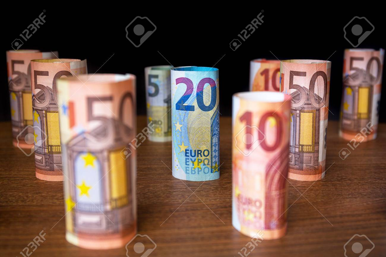 Rolled up euro banknotes on the desk Stock Photo - 75164562