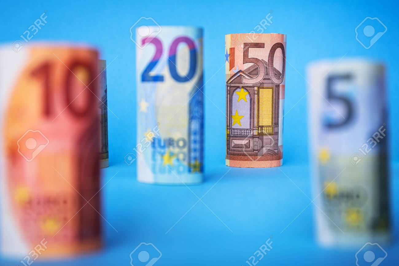 Rolled up euro banknotes on blue background Stock Photo - 75145319