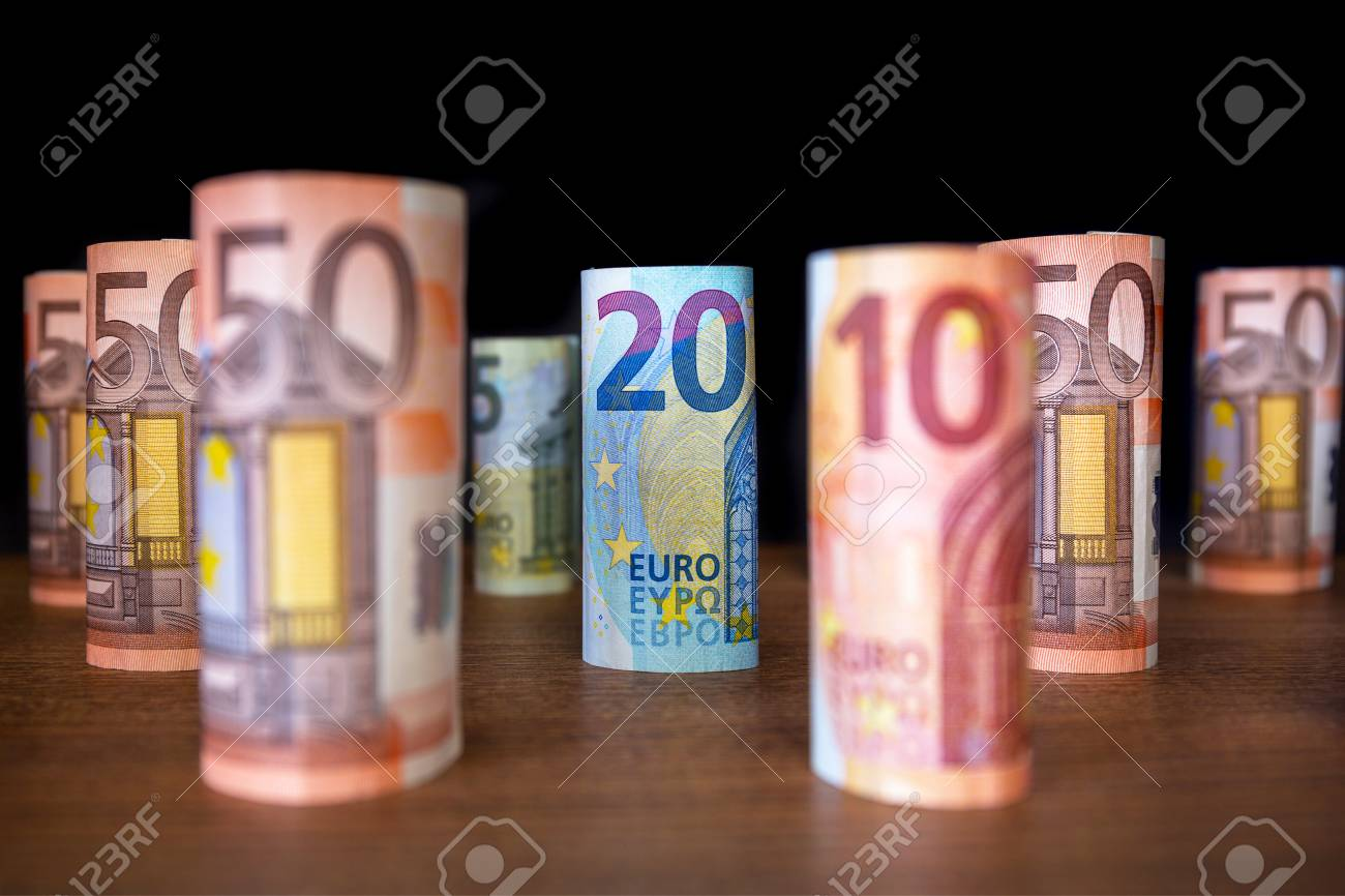 Rolled up euro banknotes on the desk Stock Photo - 75145318