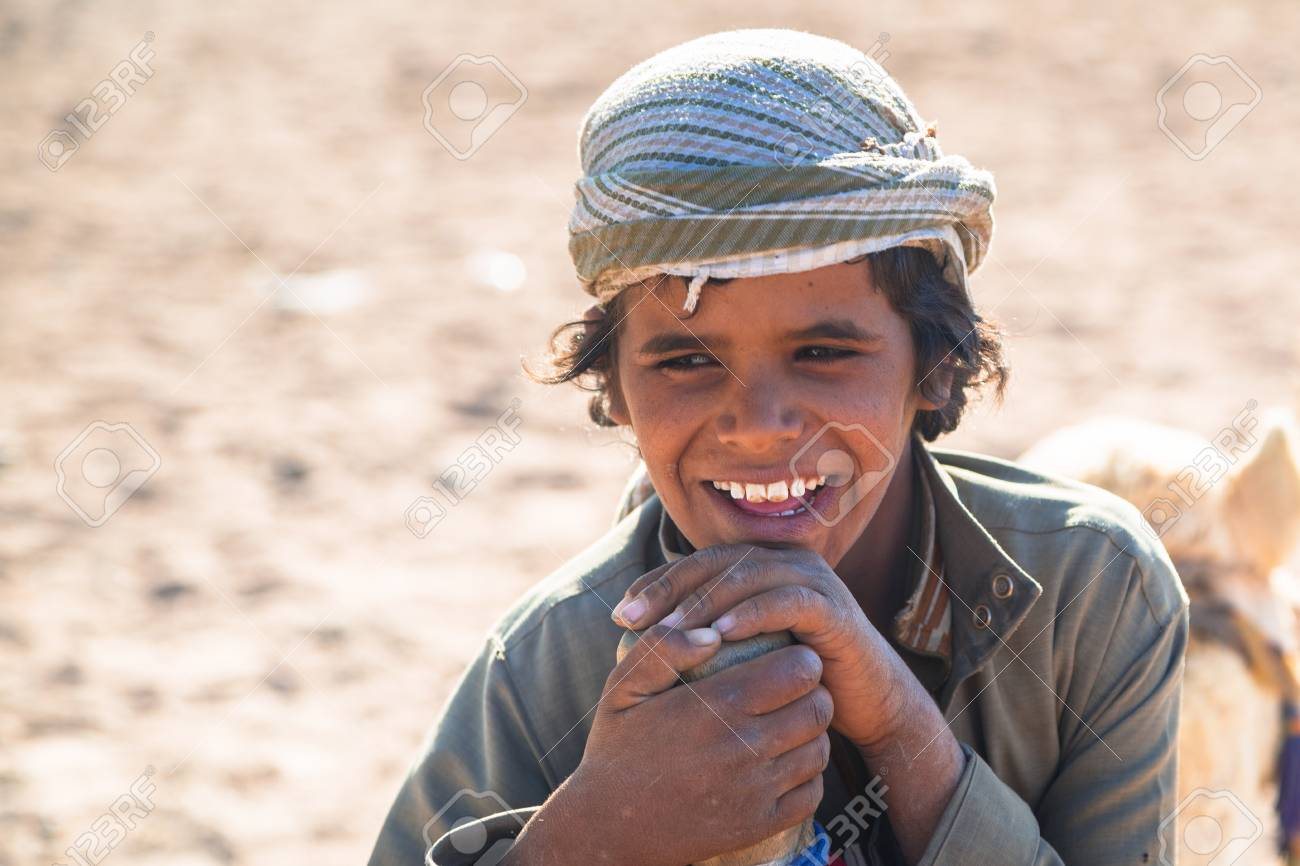 Hurghada Egypt April 16 2013 Little Boy Leading A Camel Stock Photo Picture And Royalty Free Image Image 99672429