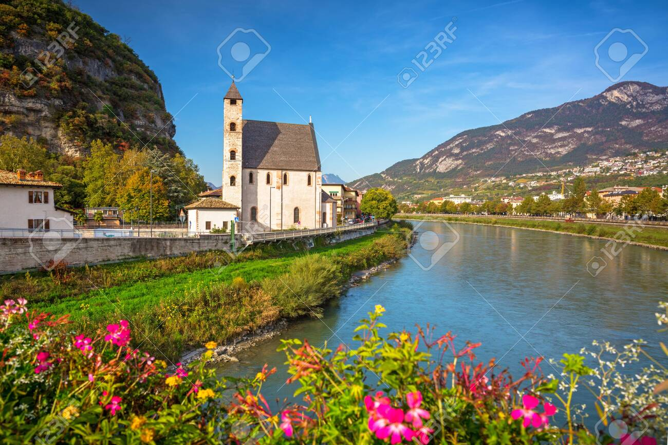 Beautiful scenery of Trento city with Saint Apollinare church at Adige river, Northern Italy - 136055363