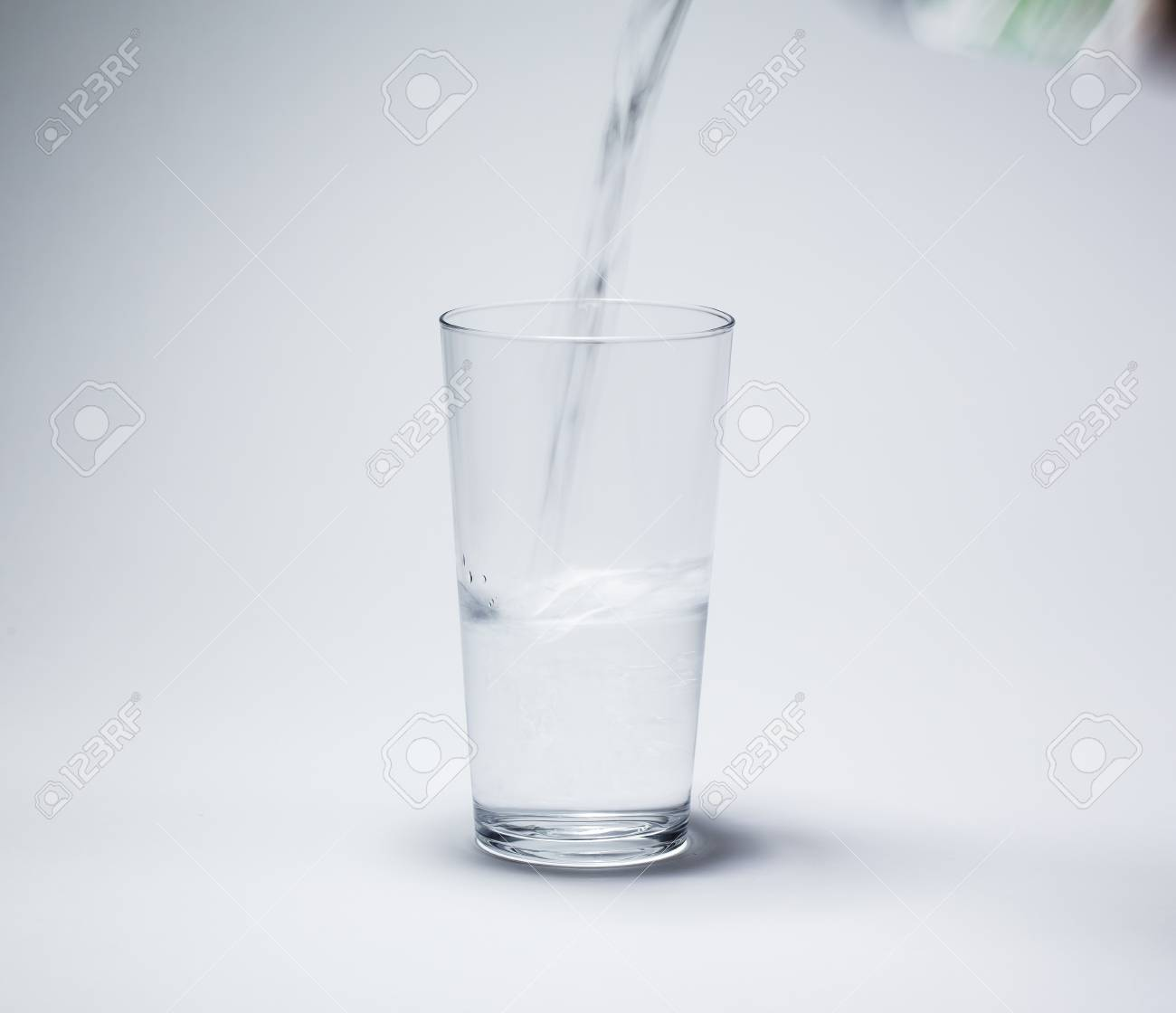 52e6663d3bb glass water drinking isolated on white background Stock Photo - 42563995