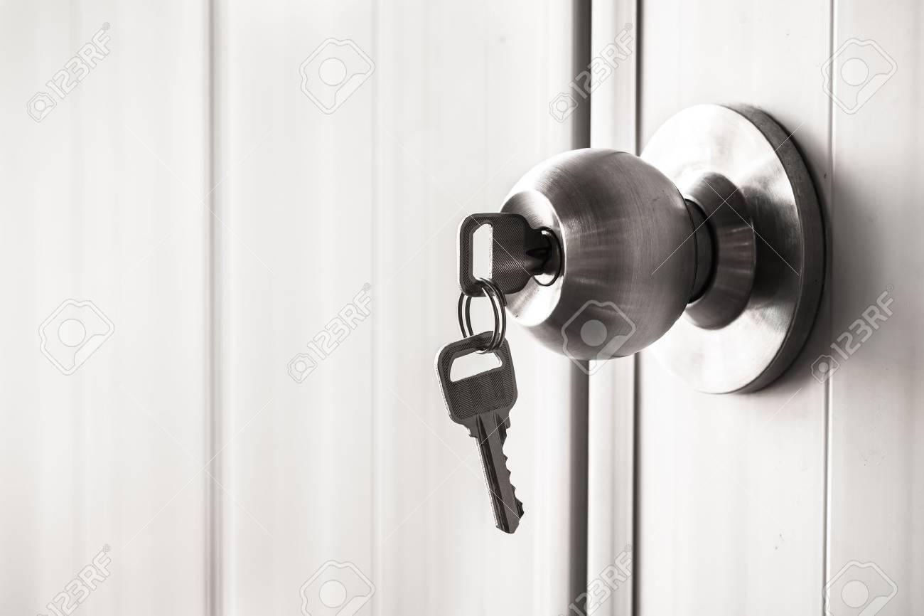The white door with metal doorknob is lock - 47405116