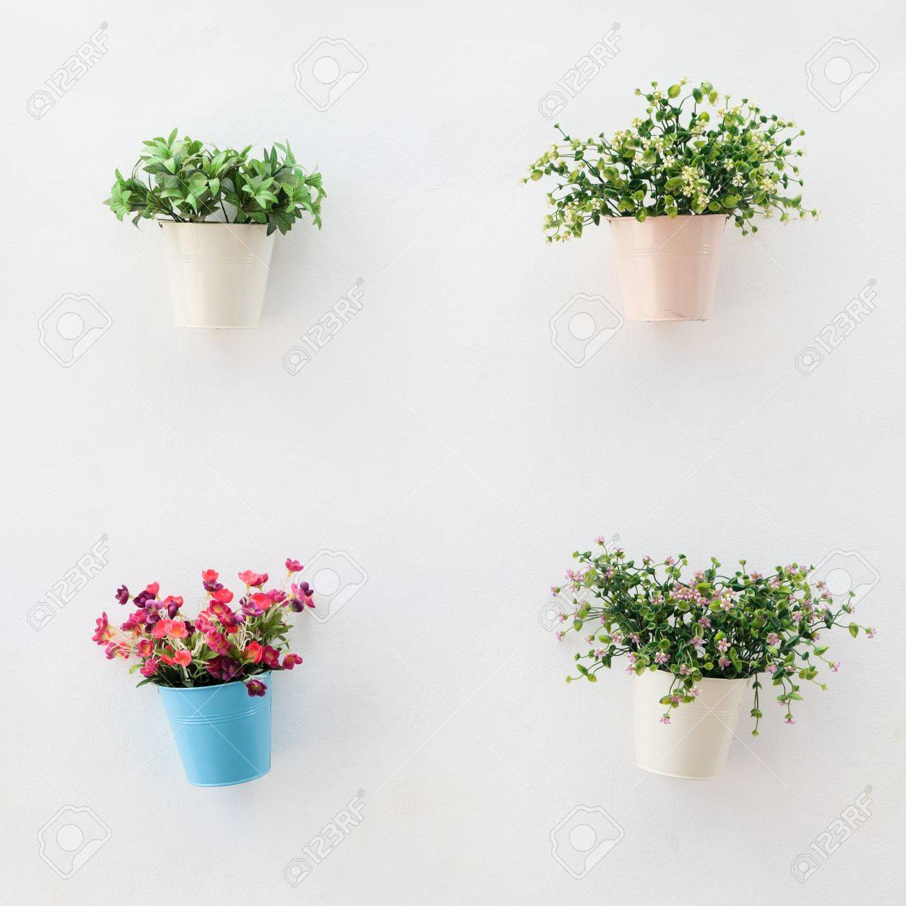 Colorful flowerpots on the white concrete wall Stock Photo - 18781730