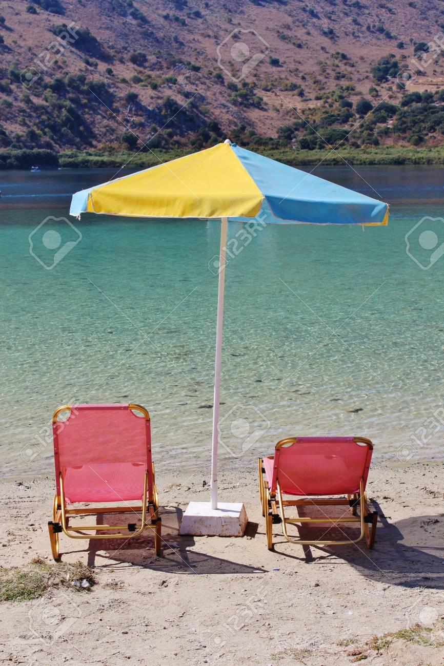 Sunbeds and parasol, Kournas Lake, Crete Stock Photo - 16759462
