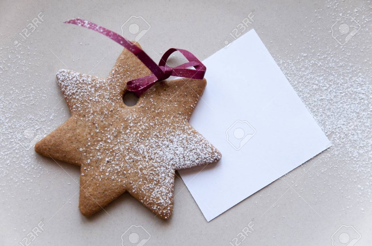 Holiday cookie star with paper note Stock Photo - 11919158