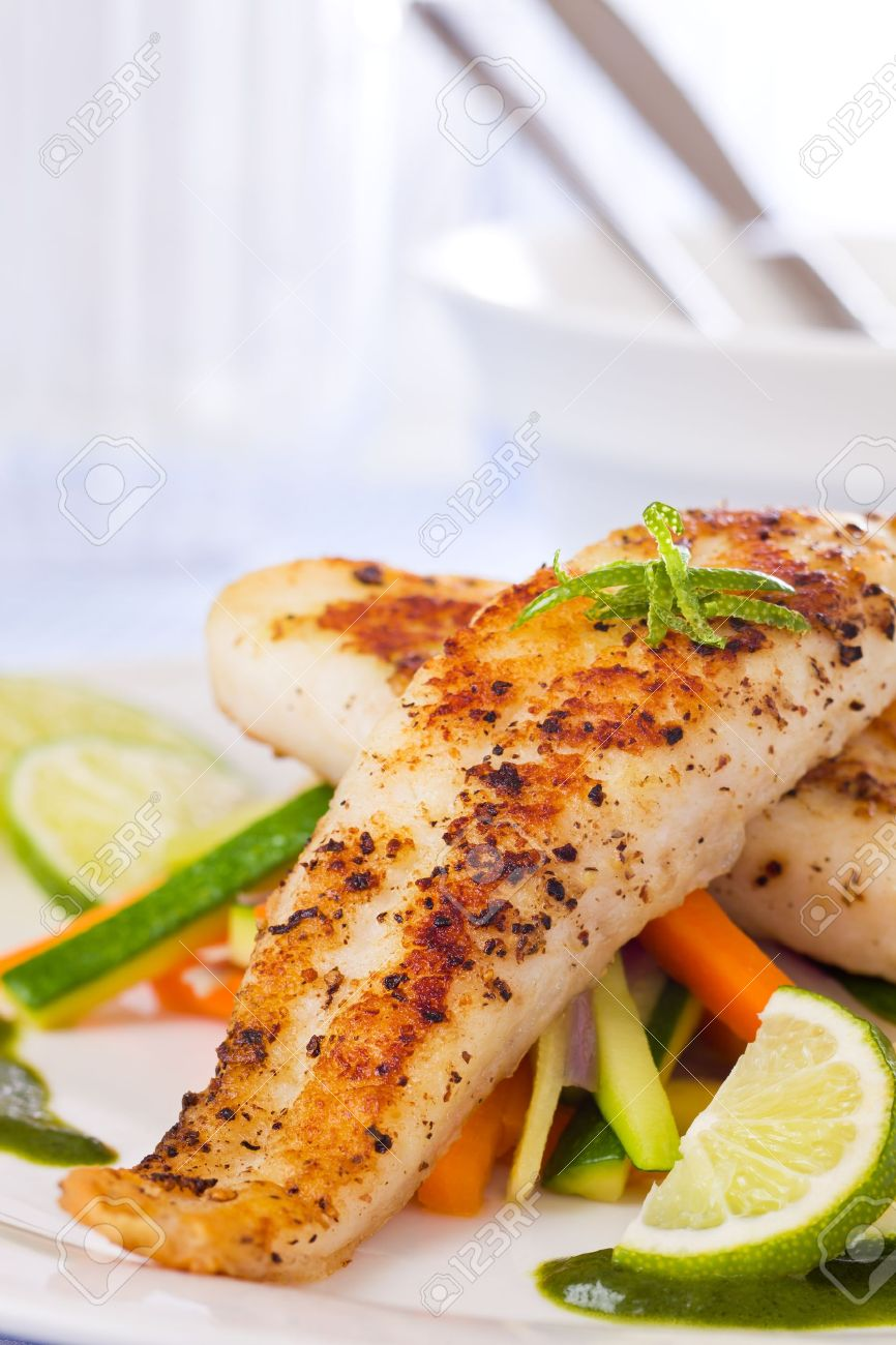 Roasted pangasius fish meal with vegetable in a white plate. Stock Photo - 9378187
