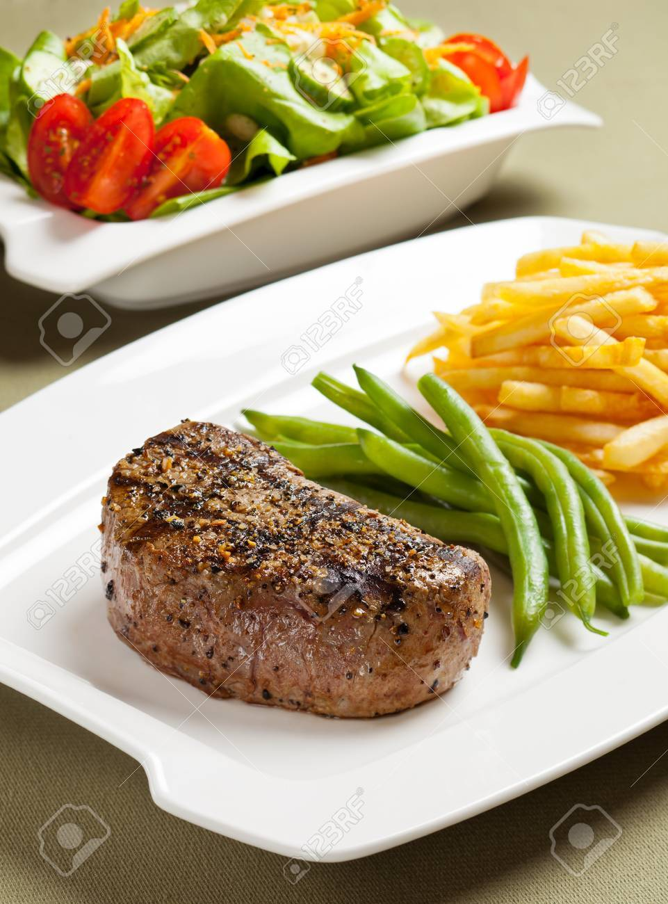 Steak with vegetable and french fries. Stock Photo - 10418977