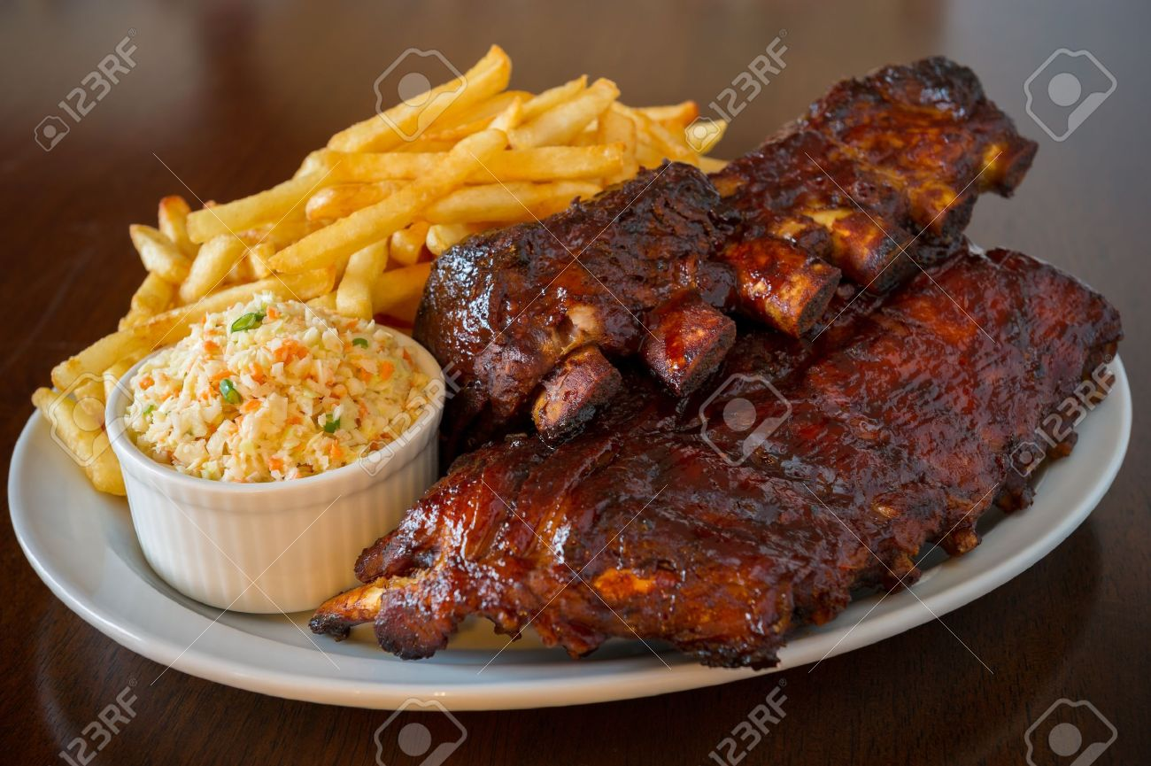 Pork ribs back with french fries and coleslaw salad on the side. Shallow depth of field. Stock Photo - 12874102