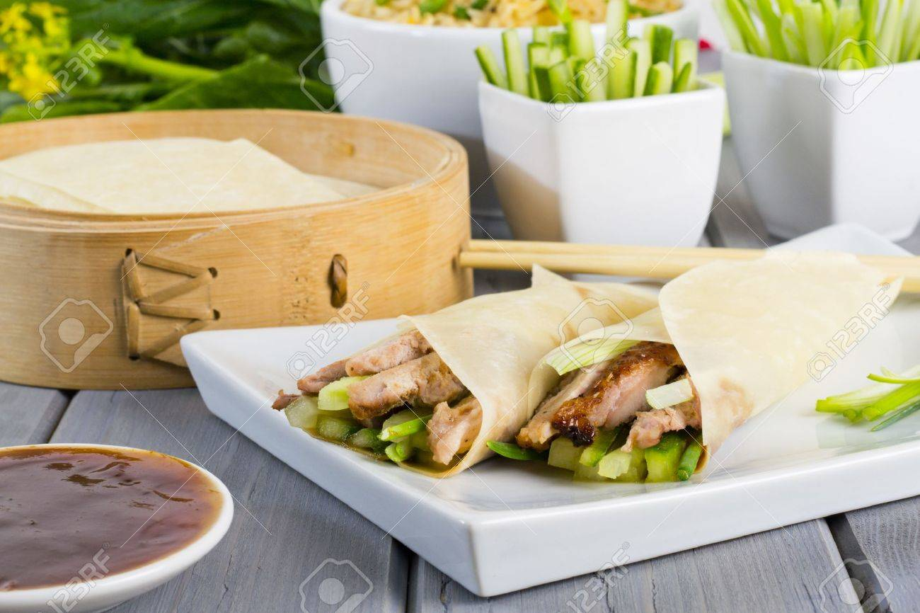 Peking Duck Chinese Peking Duck Wrapped In Pancakes With Cuber Spring Onions And Hoisin