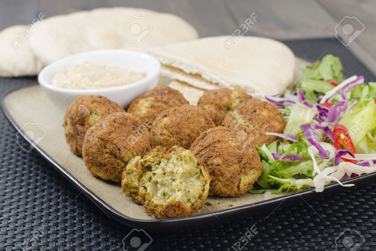 Falafel - Deep fried chickpeas balls served with tahini, salad and pitta bread Stock Photo - 15532214