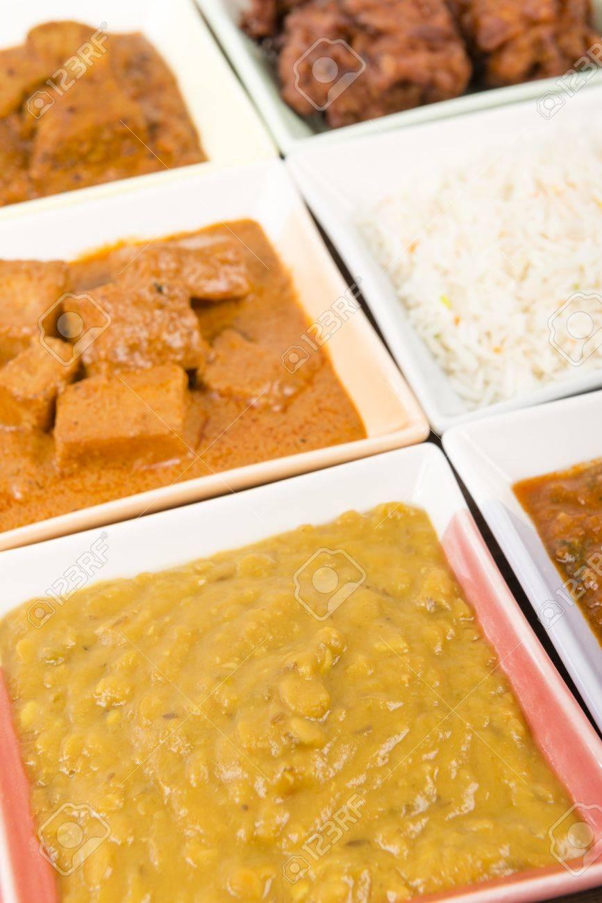 Thali - Indian meal set with vegetarian and meat curries - pork vindaloo, keema madras, tarka dal and paneer makhani Stock Photo - 18036243