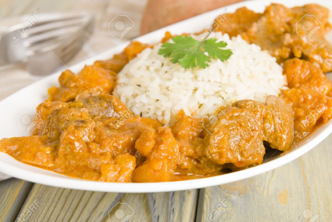 Lamb And Sweet Potato Peanut Stew Served With White Rice Caribbean