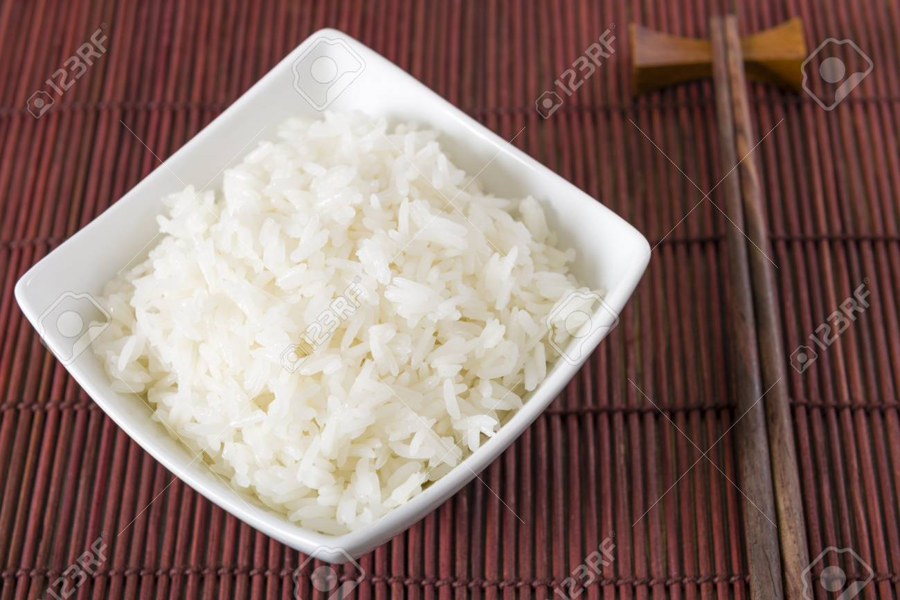 Rice - Bowl of steamed white rice and chopsticks Stock Photo - 21928330
