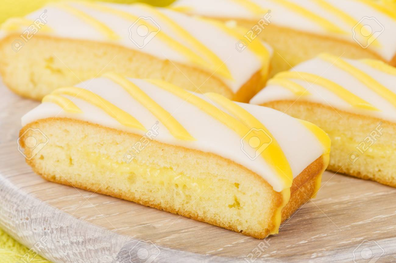 Lemon Drizzle Cake Slices Of Lemon Cake Topped With Icing Stock